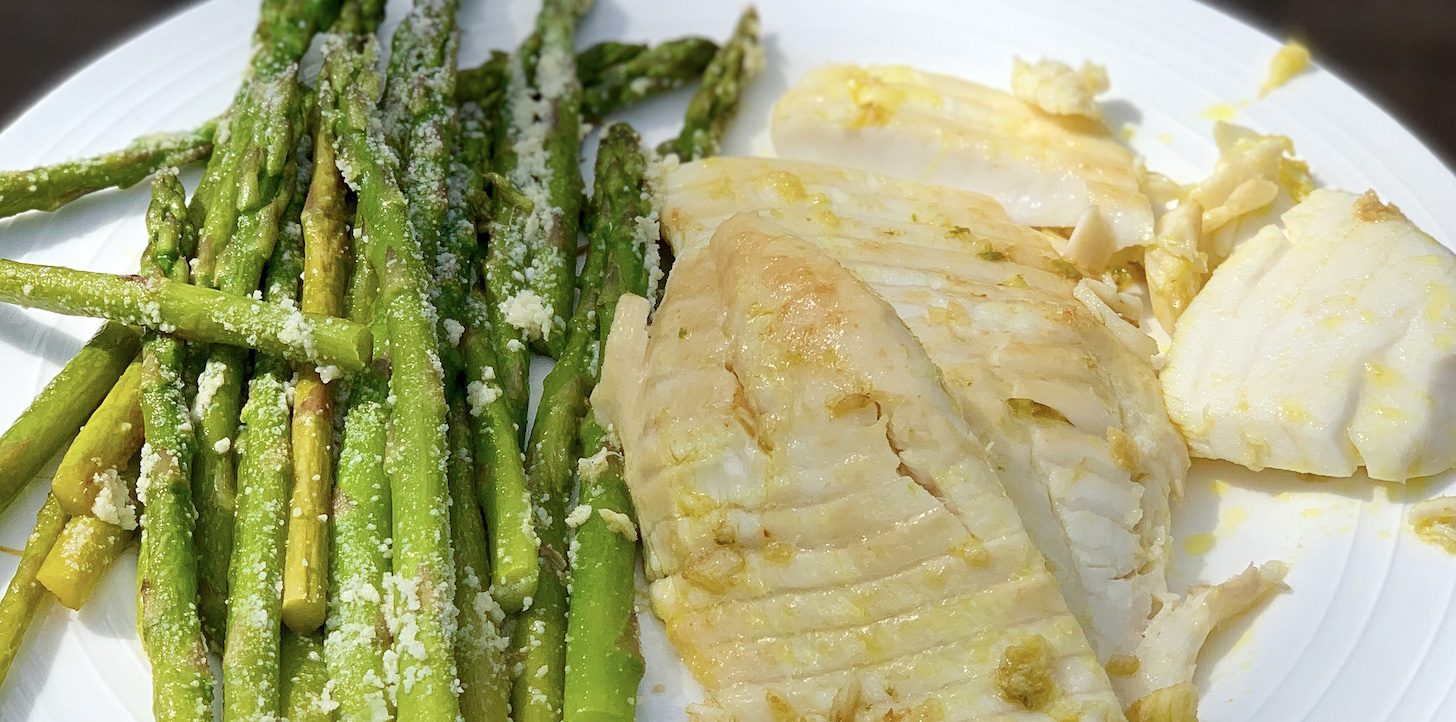 Asparagus and fish on a plate