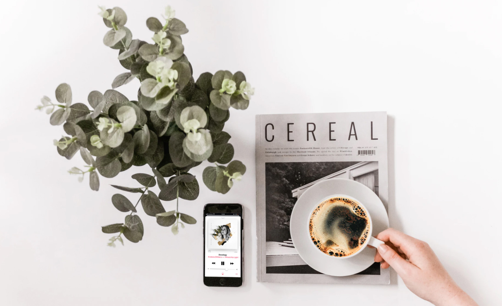 Person drinking coffee and listening to music. Unsplash - Sincerely Media