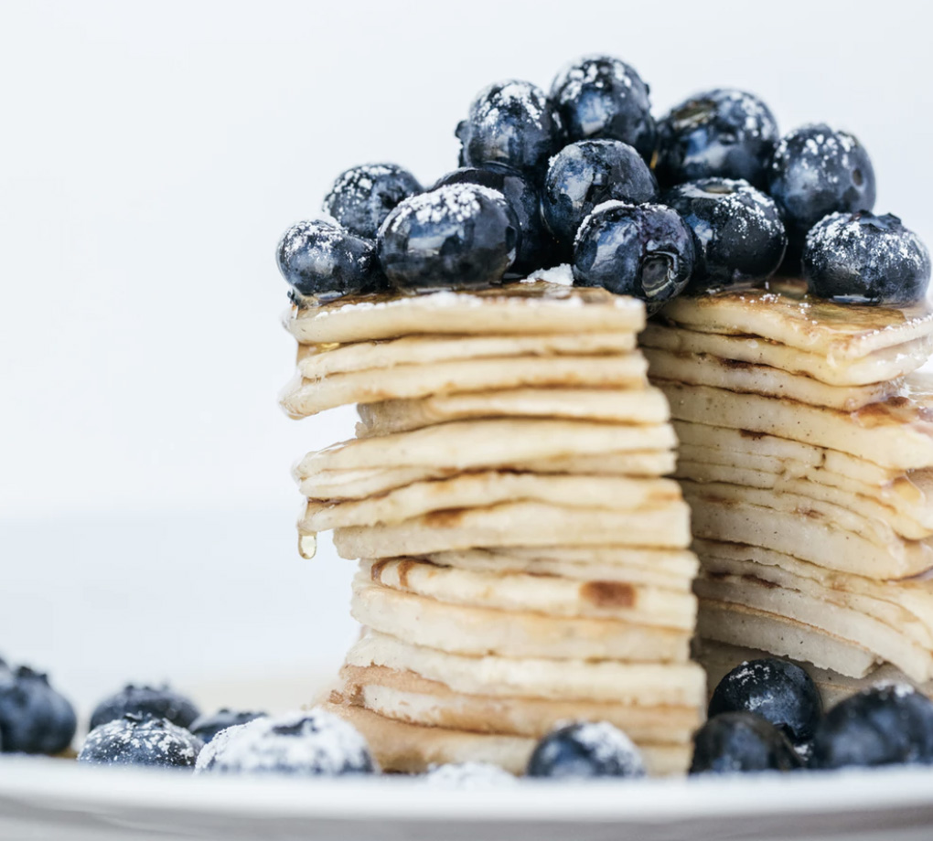 A stack of pancakes with blueberries on top