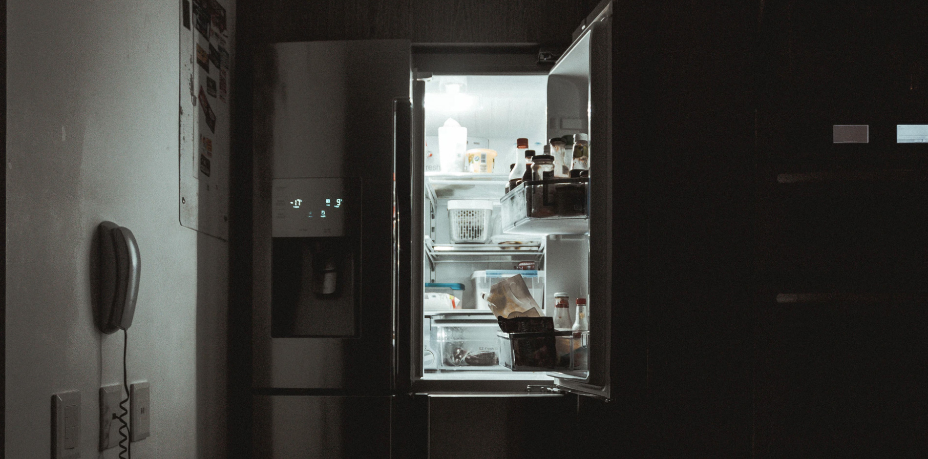 An open fridge door with food inside