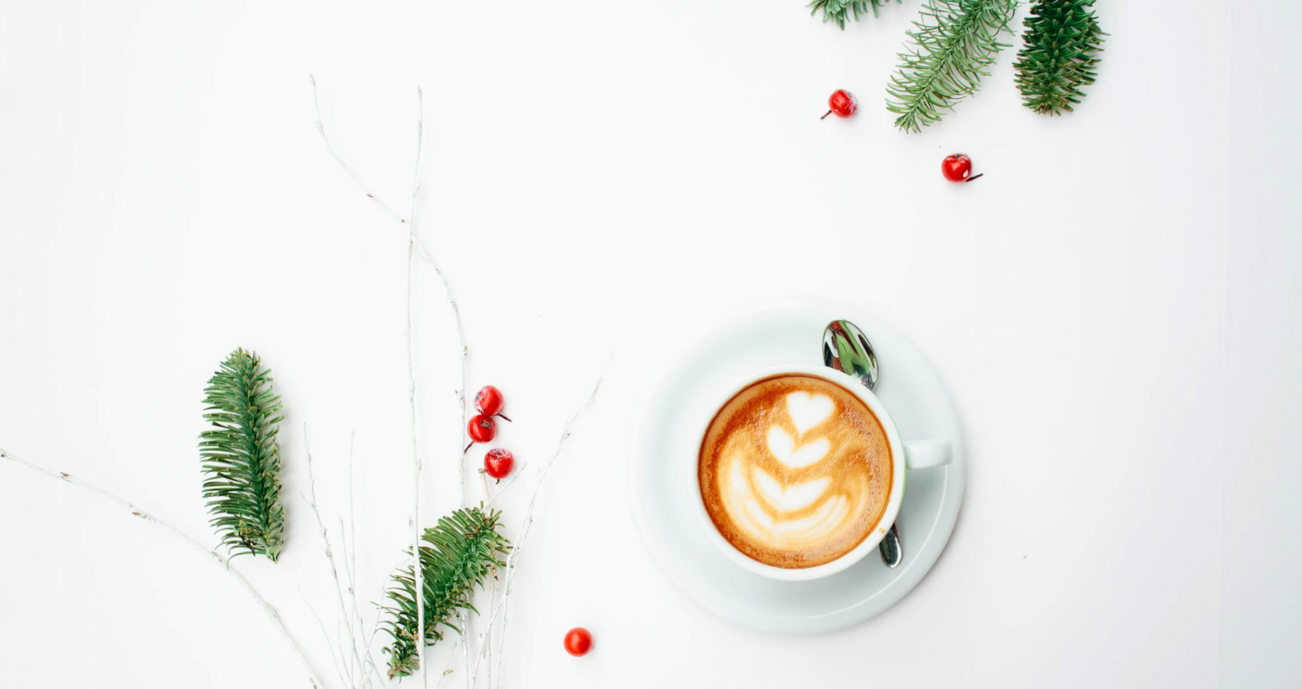 Cup of coffee and holiday decorations. unsplash - Toa Heftiba