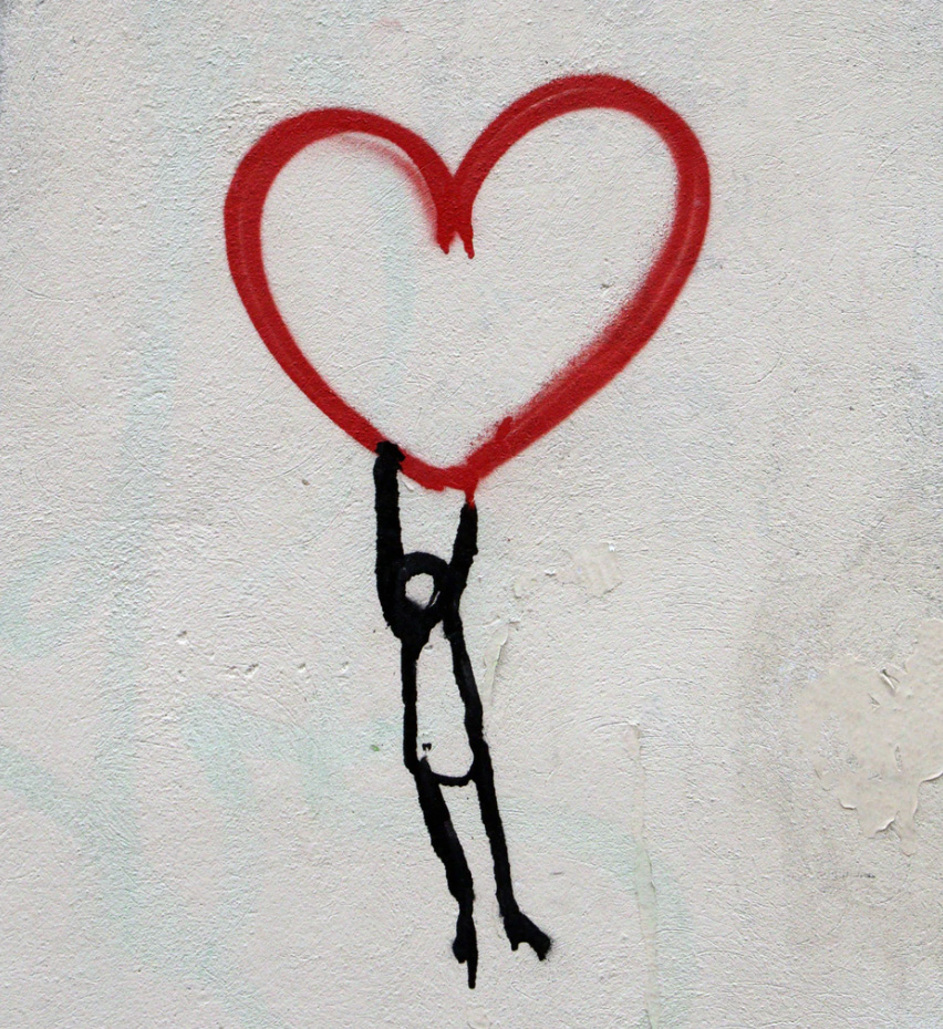 Drawing of person hanging onto a heart