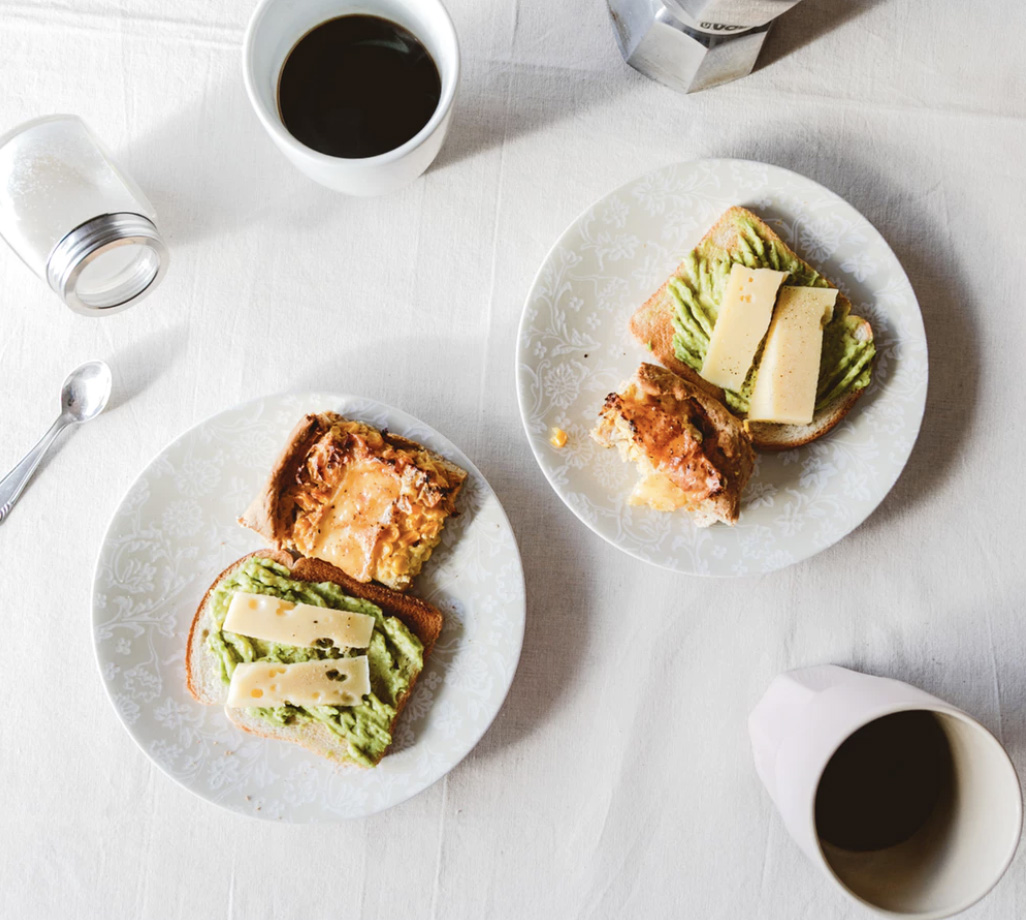 A breakfast with avocado eggs and coffee