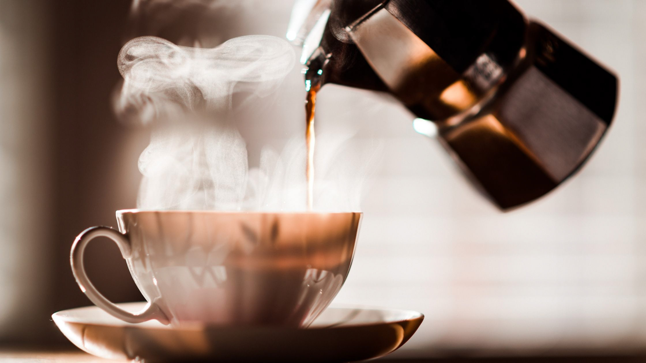 Pouring morning coffee Image - Canva