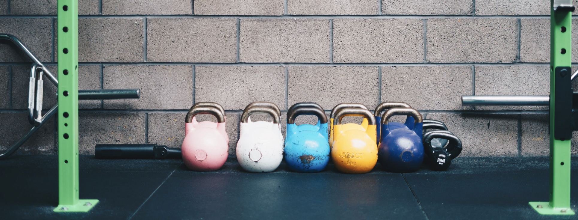 Kettlebells lined up in a gym for workout
