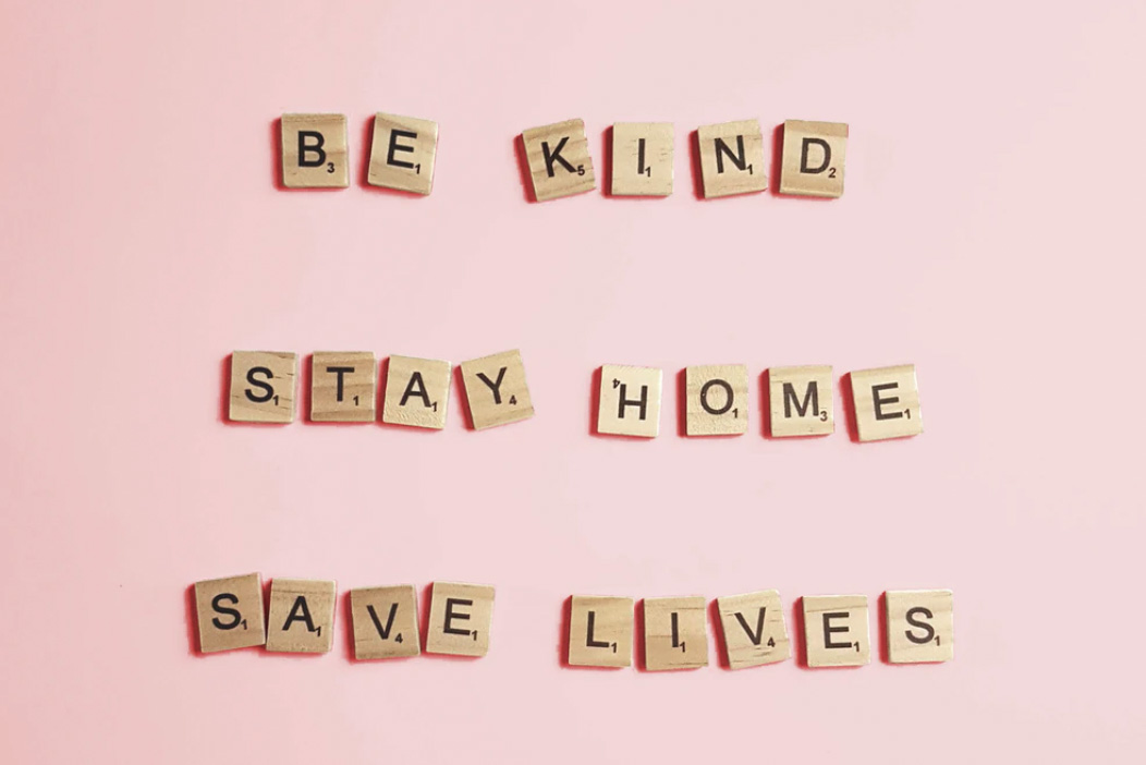 wooden tiles saying to be kind, stay home, save lives during COVID19