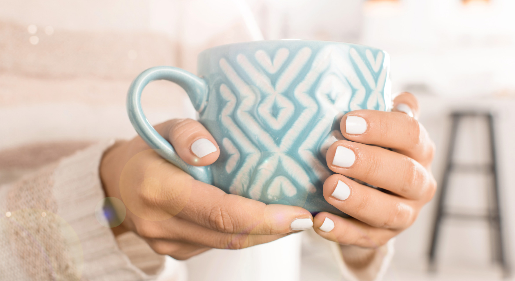 Holding a cup of tea. Image - Canva