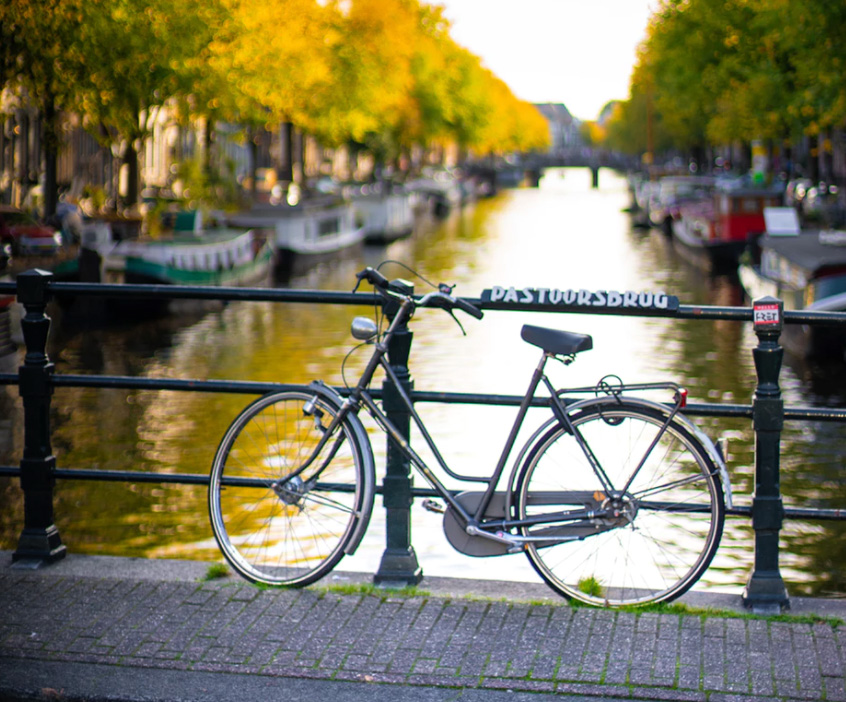 A bike against a canal.