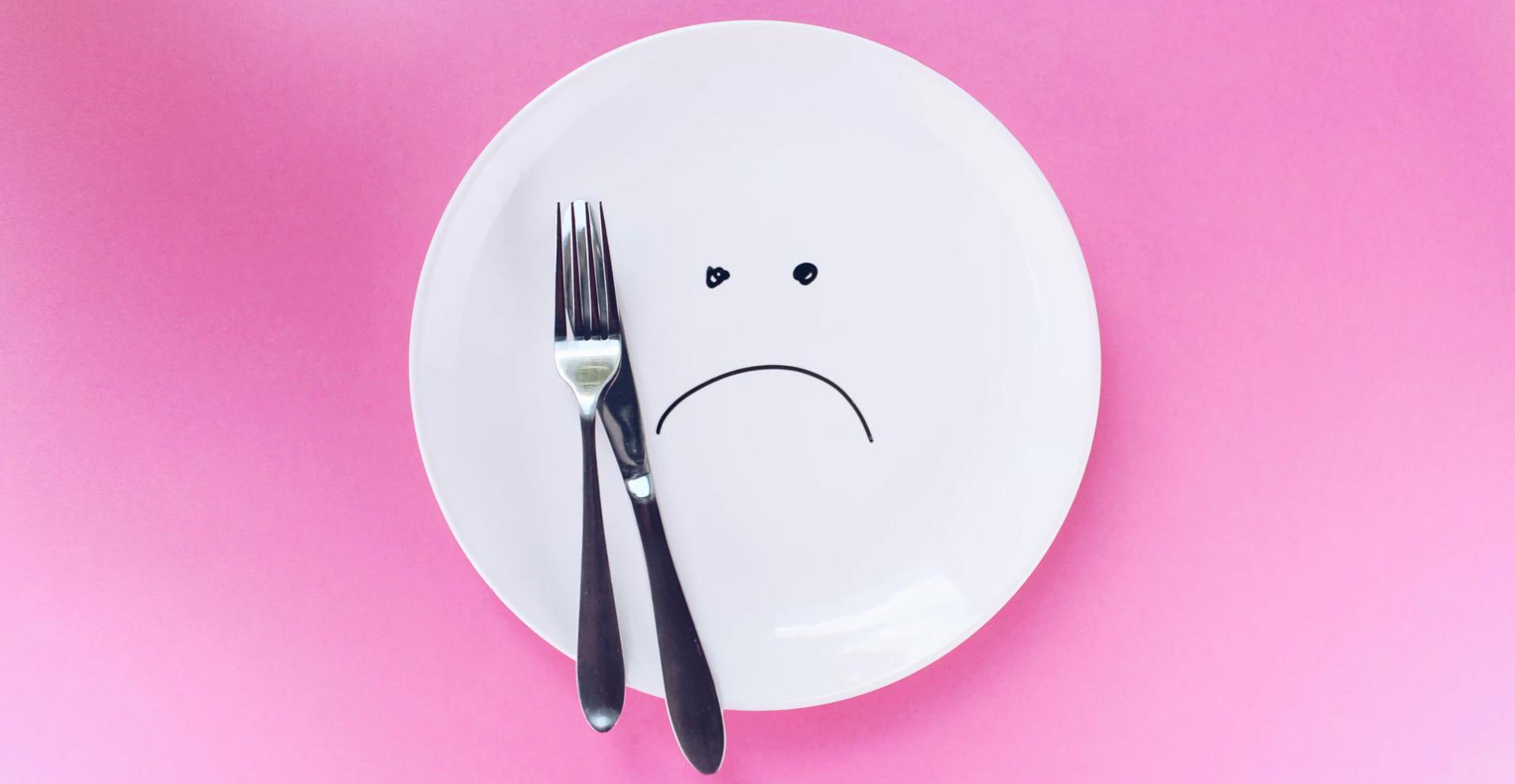 A plate with a fork and knife.